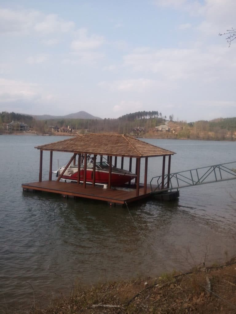 Lake Bowen Single Slip Aluminum Floating Dock with IPE Decking, Steel Walkway and Roof.