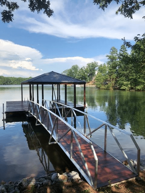 Lake Keowee Single Slip Aluminum Custom Dock with Swim Ladder and Walkway Shore View