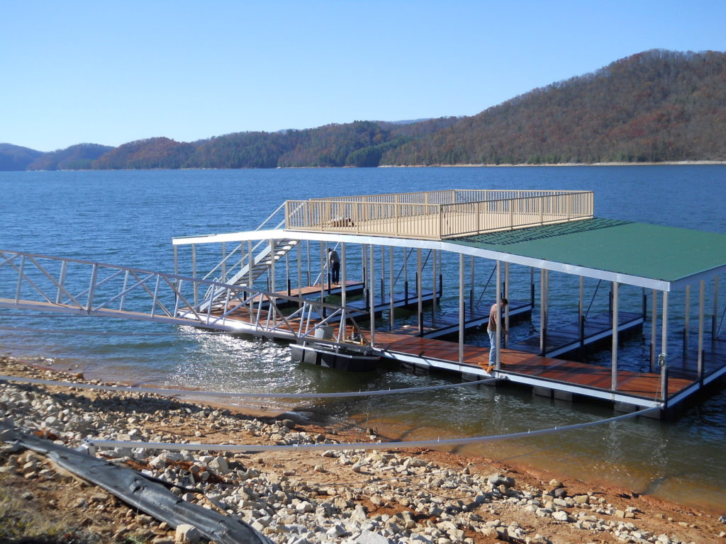 Lake Hartwell large two story multi slip floating dock with sundeck and walkway