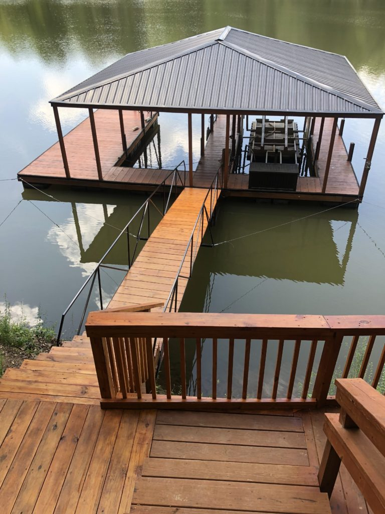 Great steel double slip dock made out of steel. It has wrapped posts, facia and skirt. Has a 30' steel walkway and burnish slate hip roof.