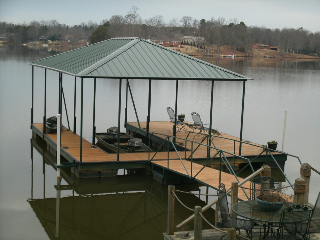 Lake Bowen Steel Floating Dock Painted Green with IPE Decking and Hip Roof.