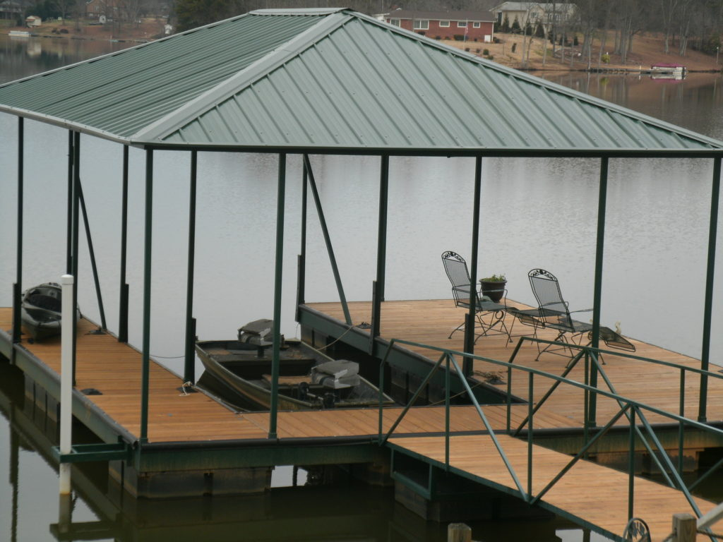 Steel Floating Dock on Lake Bowen with IPE Decking and Green Hip Roof.