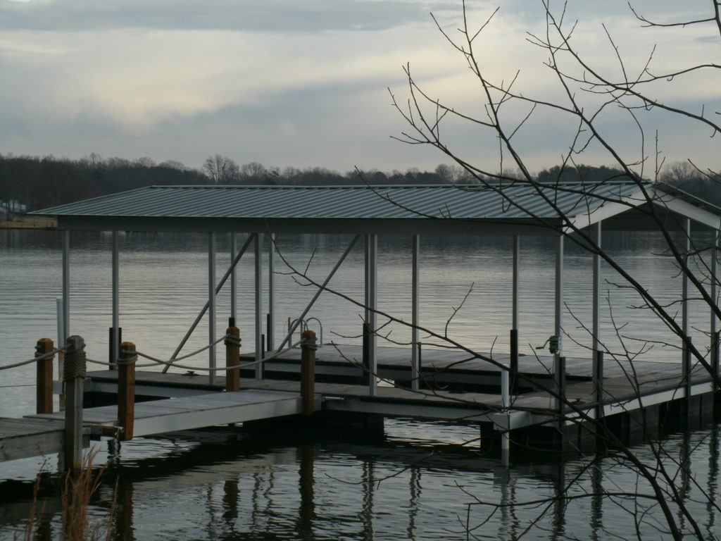 Lake Bowen Steel Floating Dock with Decking and Gable Roof Connected to Fixed Walkway.