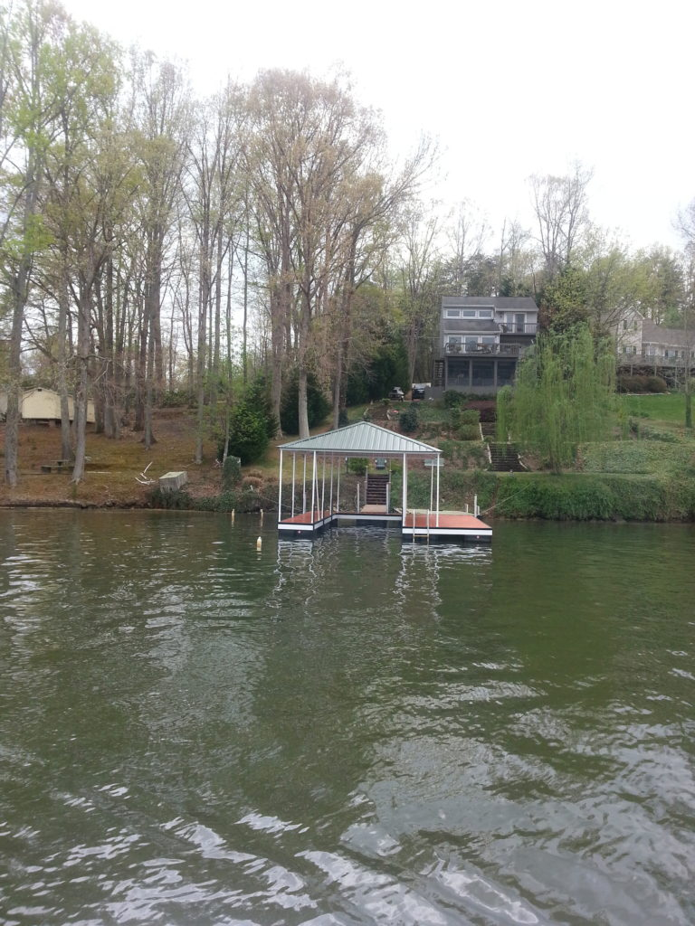 Lake Blalock Steel Floating Dock with Wide Side Left and IPE Decking and Hip Roof.