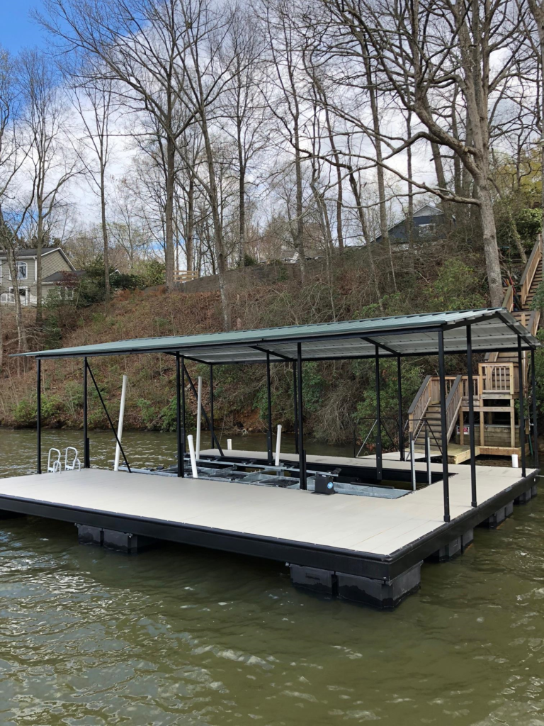 Lake Bowen Steel Floating Dock with Decking and Gable Roof Connected with Steel Walkway.