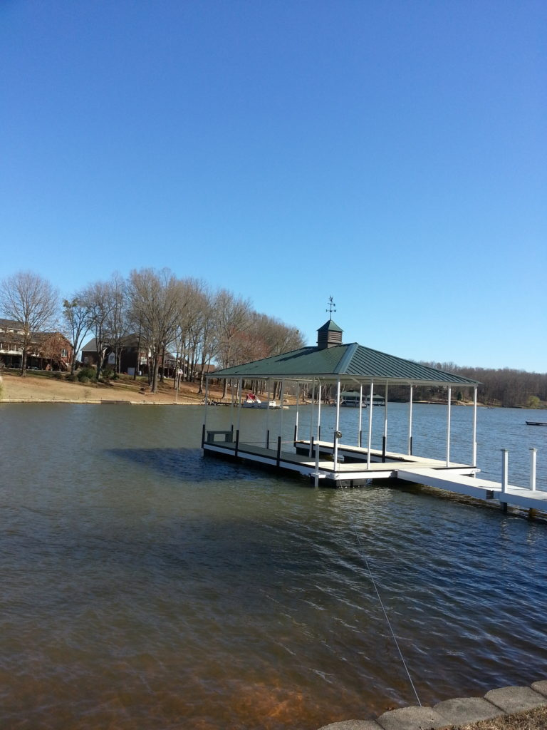 Steel Floating Dock with Aluminum Decking and Green Hip Roof and Weathervane